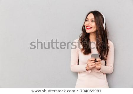 美しい 小さな ブルネット 音楽 銀 ヘッドホン ストックフォト © lithian