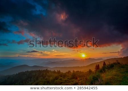 Sol enfumaçado montanhas coberto neve acima Foto stock © backyardproductions
