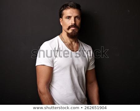 Portré brutális szakállas férfi visel póló Stock fotó © andreonegin