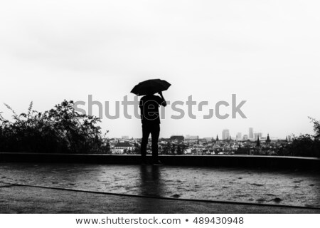 Man & Woman with Umbrella City Scape Stock photo © IS2