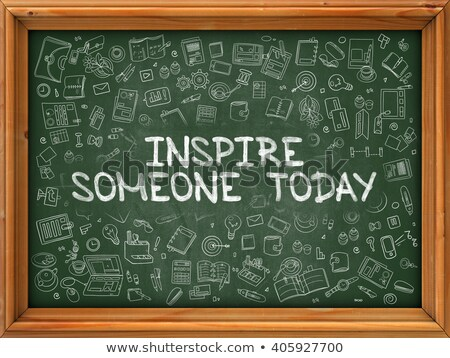 Hand Drawn Inspire Someone Today on Green Chalkboard. Stock photo © tashatuvango