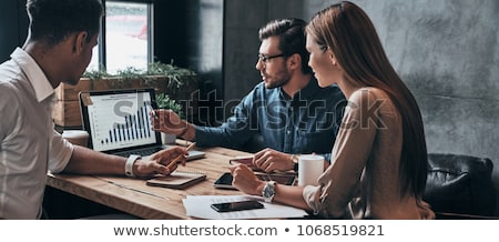 A business discussion with laptop Stock photo © IS2
