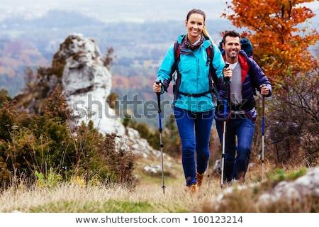 Happy girl hiker walking on mountain path, backpacker adventure Stock photo © blasbike