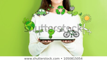 Girl holding windmill in an electric car Stock photo © IS2