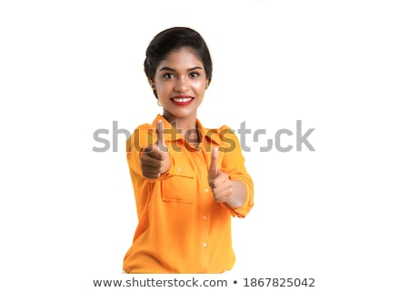 Smiling asian business woman showing ok sign and pointing Stock photo © deandrobot