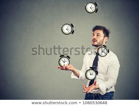 Klokken jongleren abstract idee menselijke handen Stockfoto © psychoshadow