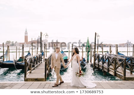 bride and groom on bridge venice stock photo © is2
