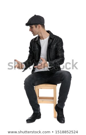 handsome cool man wearing leather jacket looks to side stock photo © feedough