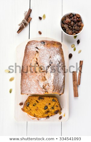Delicious pastry with raisins on white wooden table Stock photo © dash