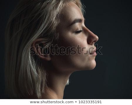Loiro mulher posando azul jeans Foto stock © acidgrey