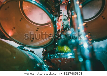 Drummer playing his drum on stage during gig Stock photo © Kzenon