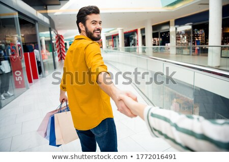 follow me. Young man leads on sale. Couple man and woman shoppin Stock photo © studiostoks