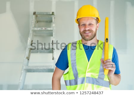 Caucasian Male Contractor With Hard Hat, Level and Safety Vest A Stock photo © feverpitch