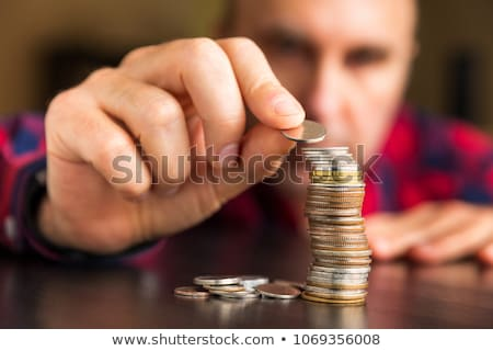Stock photo: business man counting money at the table, accounting concept