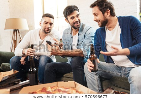 alcoholic with smartphone drinking beer at home Stock photo © dolgachov