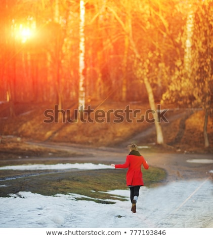 a nice woman running in snowy park stock photo © lopolo