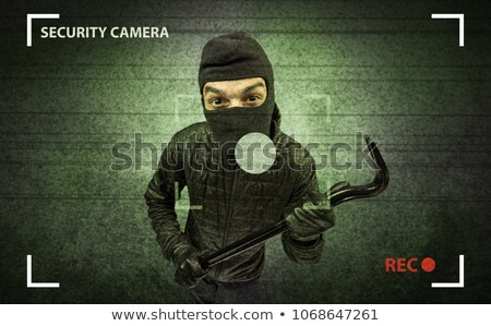 Scassinatore casa fotocamera azione nero vestiti Foto d'archivio © ra2studio
