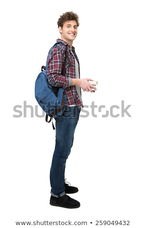 full length portrait of a cheerful young man with curly hair stock photo © deandrobot