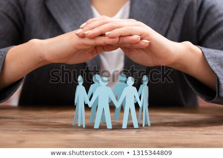 Woman Protecting Human Figures Forming Circle Stock photo © AndreyPopov