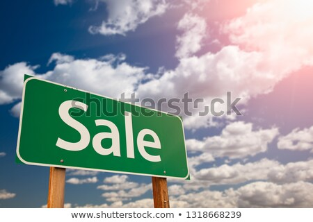 sale green road sign aginst sky stock photo © feverpitch