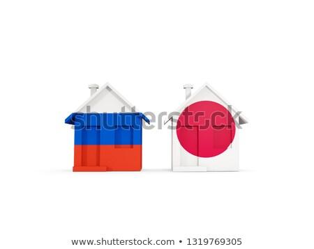 Deux maisons drapeaux Russie Japon isolé Photo stock © MikhailMishchenko