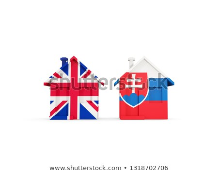 Stock photo: Two houses with flags of United Kingdom and slovakia