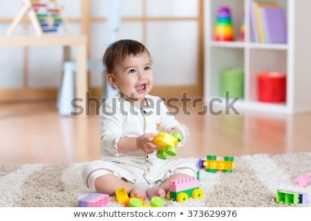 Funny cute happy baby playing on the playground. The emotion of happiness, fun, joy ストックフォト © galitskaya