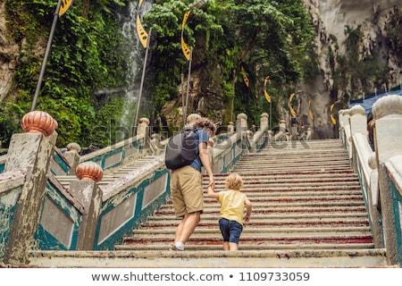 father and son in the background of batu caves near kuala lumpur malaysia traveling with children stock photo © galitskaya
