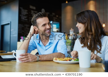 beautiful woman spending time in cafeteria stockfoto © neonshot
