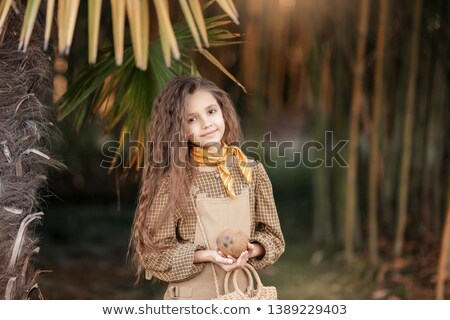 A Caicasian girl with coconut processing in the Mekong Delta Ben Tre, Vietnam. Stock photo © ElenaBatkova