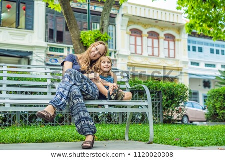 Mom and son in the background of Old houses in the Old Town of Georgetown, Penang, Malaysia Stock photo © galitskaya
