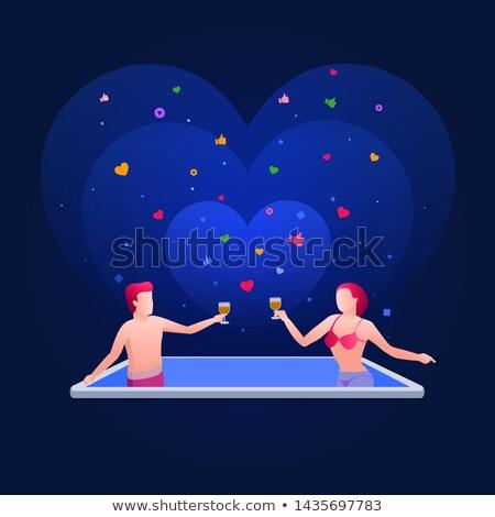 handsome man and bikini girl are in the smart phone pool stock photo © sgursozlu