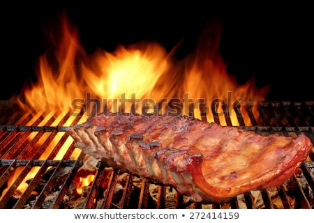 Rack of lamb on barbecue with flame and smoke Stock photo © sarahdoow
