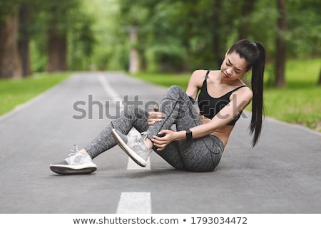 Female Jogger Suffering From Ankle Injury Stock photo © AndreyPopov