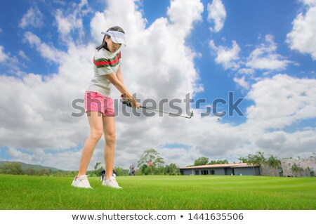 Woman golf player pitching. Stock photo © lichtmeister