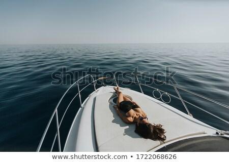 Młodych atrakcyjna kobieta relaks luksusowe jacht Zdjęcia stock © boggy