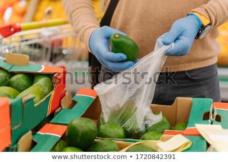 Imagem homem borracha médico luvas abacate Foto stock © vkstudio
