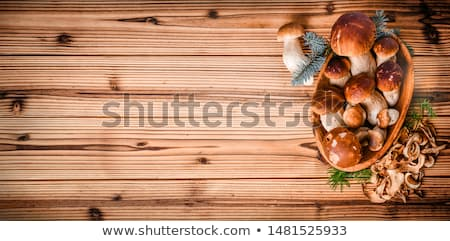 brown cap boletus mushrooms on wooden background Stock photo © dolgachov