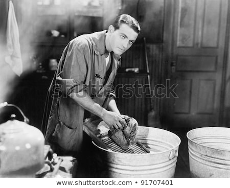 Três homens trabalhos domésticos quarto tecido piso Foto stock © photography33