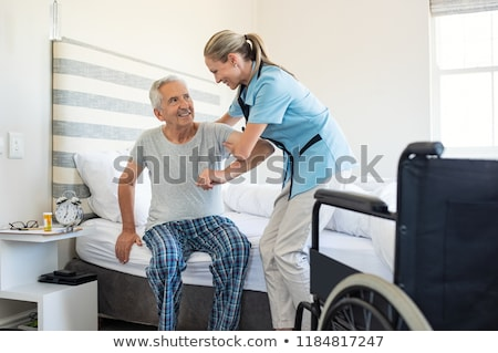 nurse helping man in wheelchair stock photo © photography33