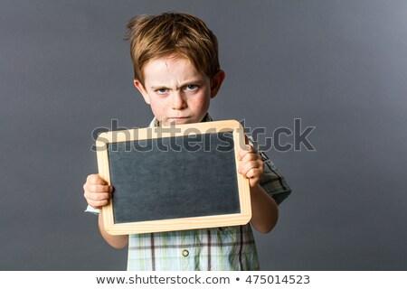 mały · chłopca · piśmie · tablicy · widok · z · tyłu - zdjęcia stock © photography33