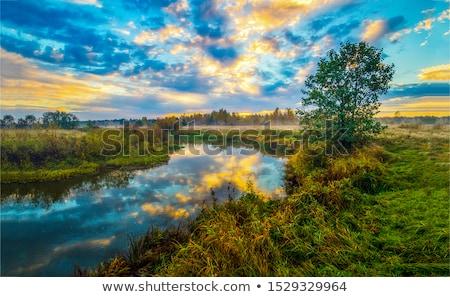 Nehir gün batımı sakin dağ siluet su Stok fotoğraf © iTobi