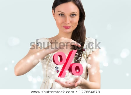 Portrait of young girl holding discount symbol in her arms Stock photo © HASLOO