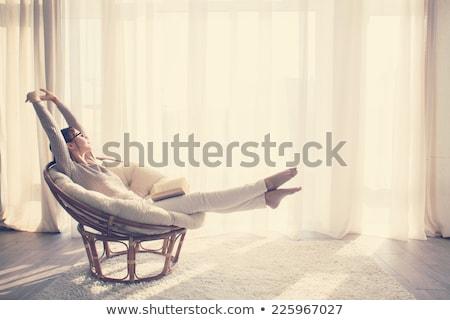 Bela mulher relaxante cadeira vista lateral retrato sorridente Foto stock © fantasticrabbit