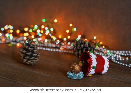 christmas background with wood bucket cones color balls and be stock photo © elmiko