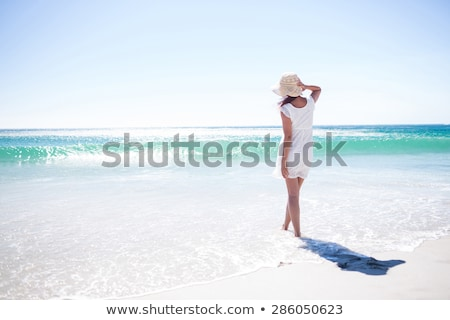 Beautiful young brunette relaxing on the beach Stock photo © amok