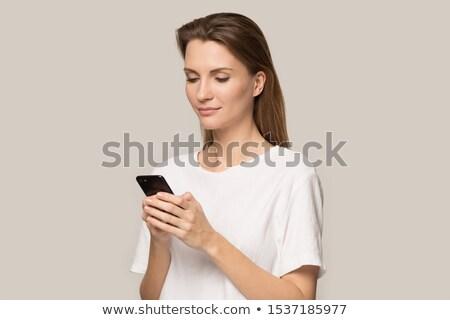 Attrattivo donna lettura sms Foto d'archivio © dash