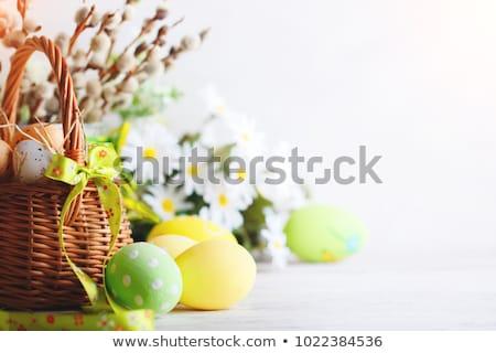 Paskalya tebrik kartı renkli paskalya yumurtası gıda ahşap Stok fotoğraf © SelenaMay
