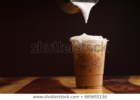 Stock photo: Ice caffe mocha serving on wooden table