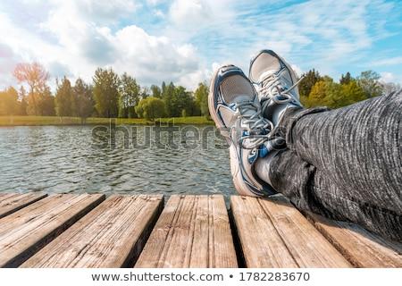 человека ног расслабляющая берег реки пирс случайный Сток-фото © stevanovicigor